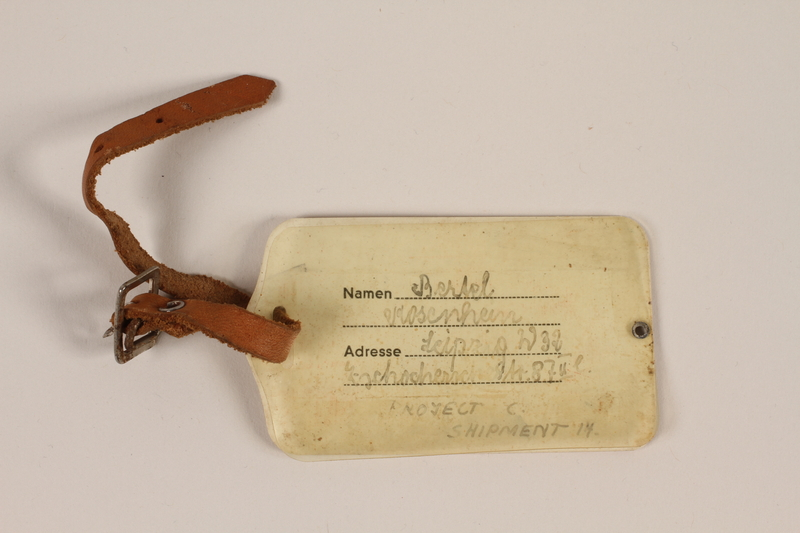 1998.102.1 back Luggage tag used by a Jewish girl during a Kindertransport