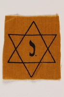 1998.118.1 front Yellow cloth Star of David badge with the letter J. to identify a Belgian Jew  Click to enlarge