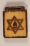 Small wooden tile with a Star of David and a cracked eggshell made by a former Jewish Czech concentration camp inmate