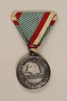 1998.131.4 back Medal  Click to enlarge