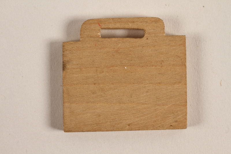 1989.342.8 front Small blank wooden tile made by a former Jewish Czech concentration camp inmate