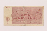 1998.20.1 back Theresienstadt ghetto-labor camp scrip, 2 kronen note, owned by a child inmate  Click to enlarge