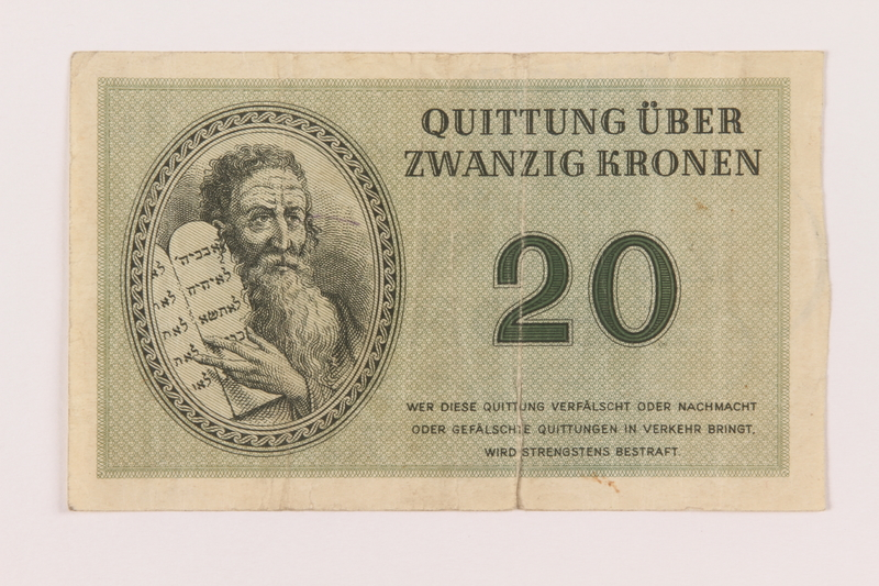 1998.20.3 front Theresienstadt ghetto-labor camp scrip, 20 kronen note, owned by a child inmate
