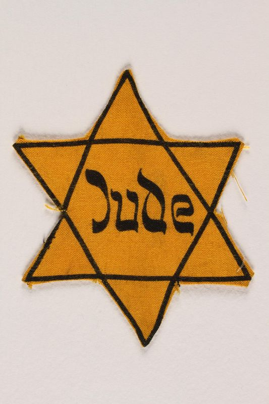 1998.20.5 front Star of David badge with Jude printed in the center