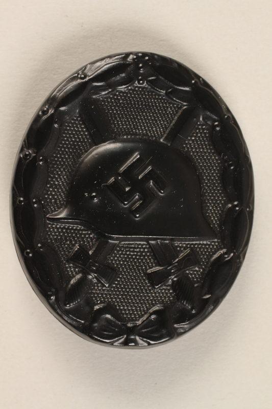 1998.55.2 front WWII German black wound badge issued to a WW I veteran
