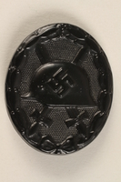 1998.55.2 front WWII German black wound badge issued to a WW I veteran  Click to enlarge