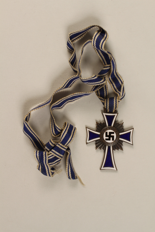 1998.58.1 front Cross of Honor of the German Mother medal, 3rd Class Order, Bronze Cross