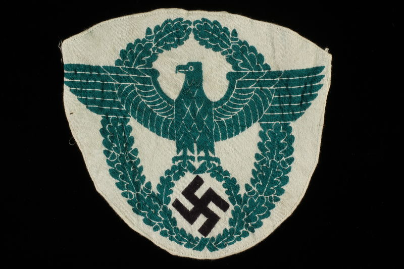 1998.58.4 front Badge bearing design of Nazi German national emblem