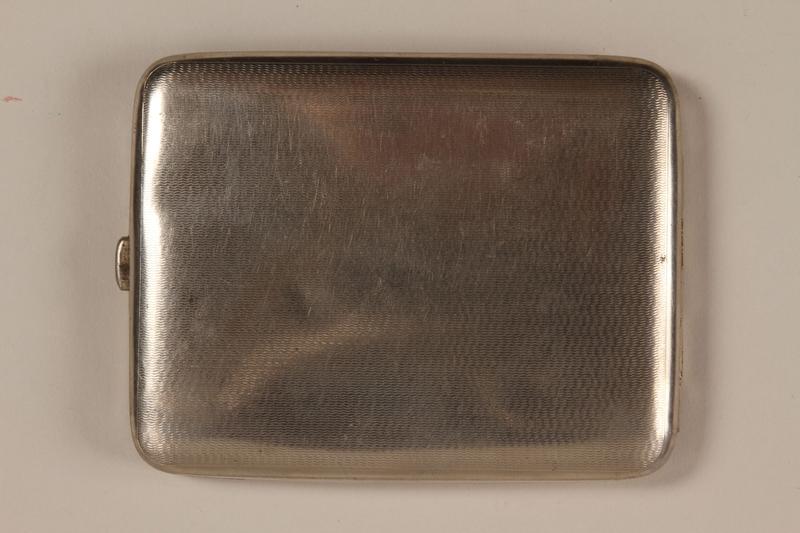 1988.66.8 back Cigarette case