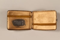 1988.66.8 open Cigarette case  Click to enlarge