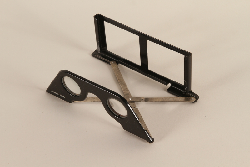 1998.92.1.1 open Stereoscopic viewing glasses to accompany book with stereoscope views on German naval history