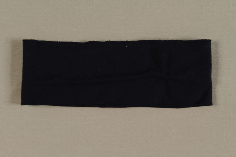 1999.100.3 front Black wool headband worn by a German Jewish displaced person