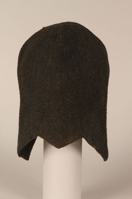 1999.100.5 front Knitted black wool cap worn by a German Jewish displaced person