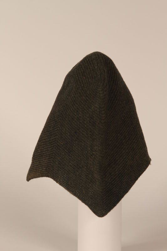 1999.100.5 side Knitted black wool cap worn by a German Jewish displaced person