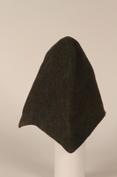 1999.100.5 side Knitted black wool cap worn by a German Jewish displaced person  Click to enlarge