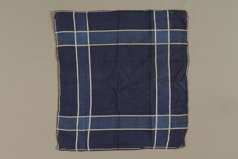 1999.100.8 front Plaid handkerchief used by a German Jewish displaced person and camp survivor