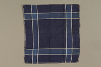 1999.100.8 front Plaid handkerchief used by a German Jewish displaced person and camp survivor  Click to enlarge