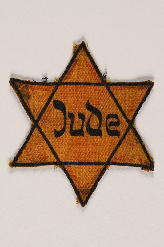1989.88.1 front Star of David badge with Jude printed in the center