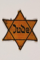 1989.88.1 front Star of David badge with Jude printed in the center  Click to enlarge