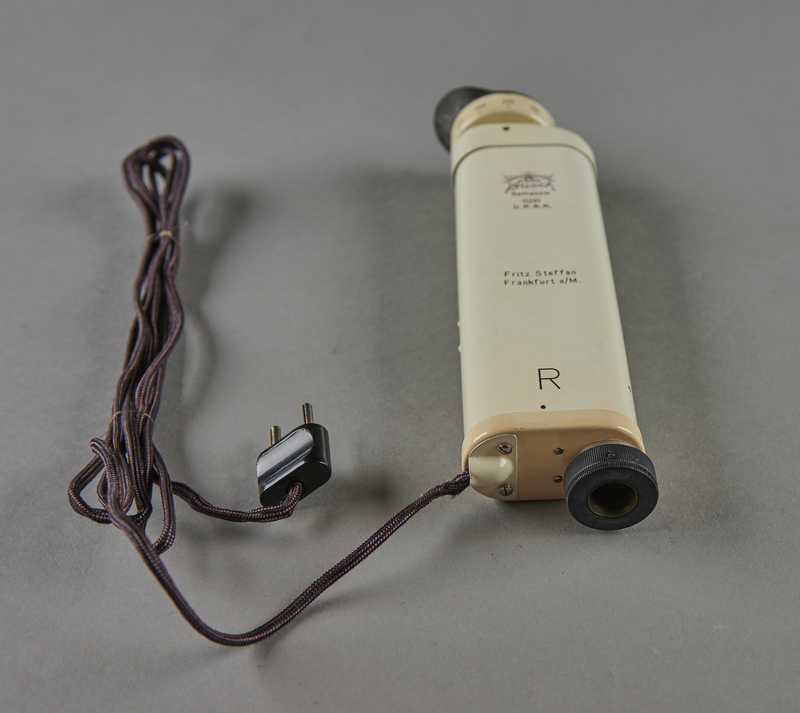 2003.451.3 front Electric retinoscope used by a Jewish German US Army medic