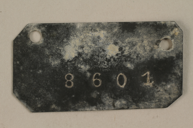 1999.122.1 front Tag