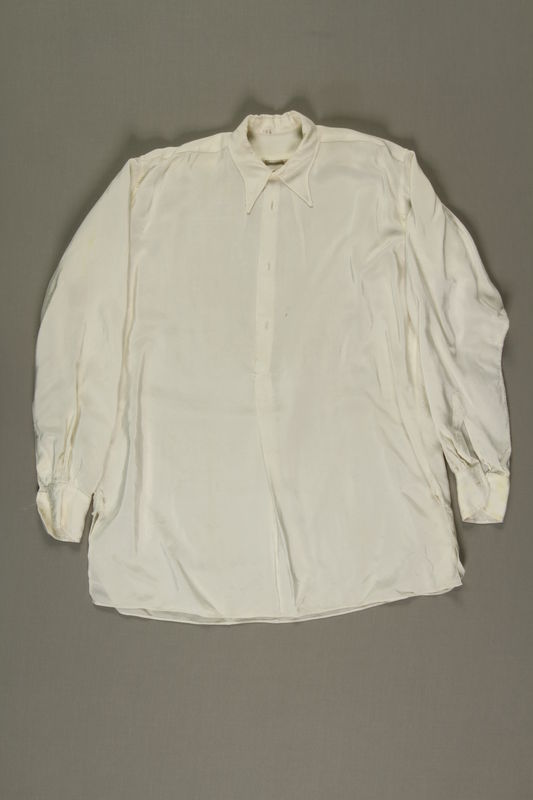 1999.126.1 front White shirt made from a rayon parachute for a Czech Jewish man for his wedding in a DP camp