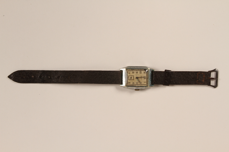 1999.155.2 front Brown strap wrist watch worn postwar by a former labor camp inmate and aid worker