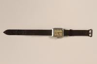 1999.155.2 front Brown strap wrist watch worn postwar by a former labor camp inmate and aid worker  Click to enlarge
