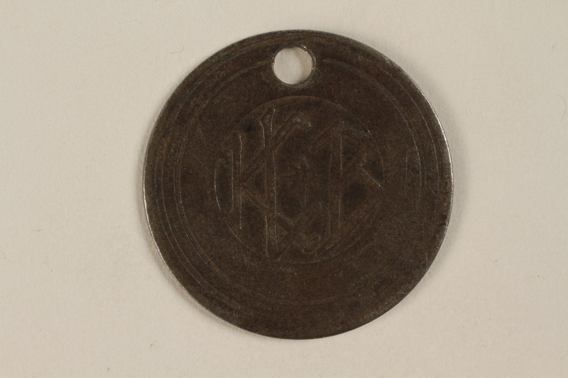 1999.187.1 front Identification tag worn in Warsaw