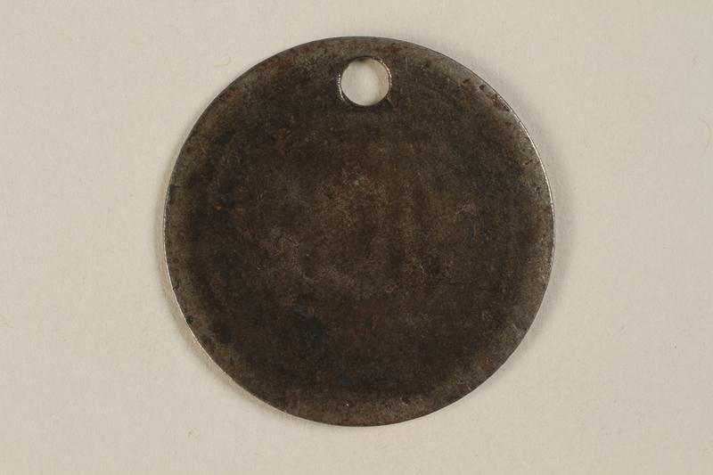 1999.187.1 back Identification tag worn in Warsaw