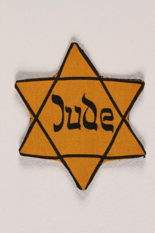 1998.204.2 front Star of David badge with Jude printed in the center