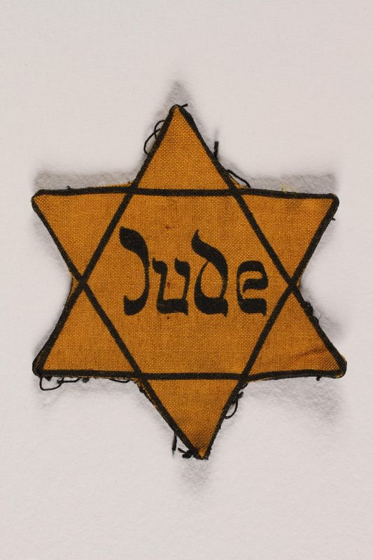 1999.204.3 front Star of David badge with Jude printed in the center