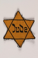 1999.204.3 front Star of David badge with Jude printed in the center  Click to enlarge