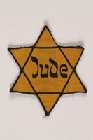 1999.204.4 front Star of David badge with Jude printed in the center  Click to enlarge
