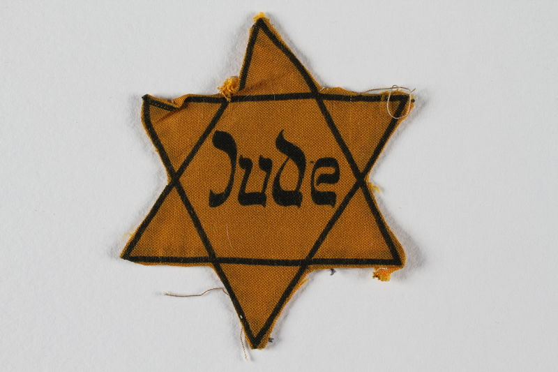 1999.204.5 front Star of David badge with Jude printed in the center