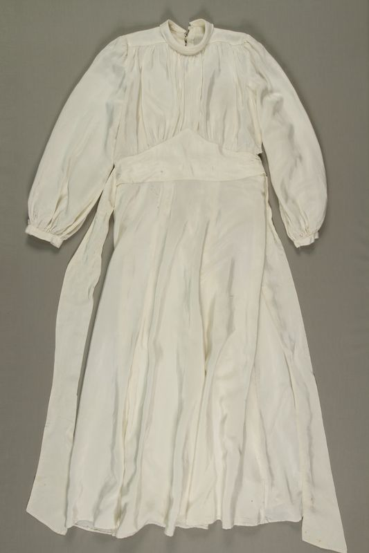 1999.7.12_a front Wedding gown made from a white rayon parachute worn by multiple Jewish brides in a DP camp