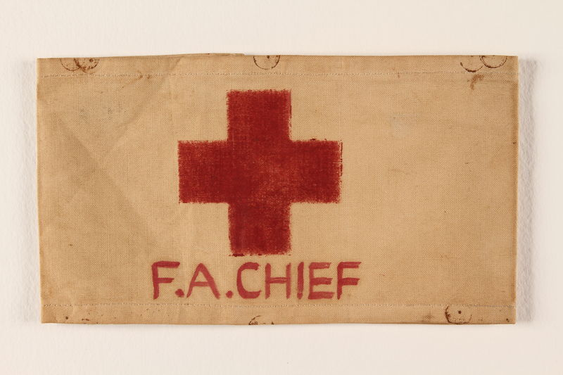 2000.129.3 front White armband printed with a red cross and F.A.Chief