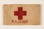 White armband printed with a red cross and F.A.Chief
