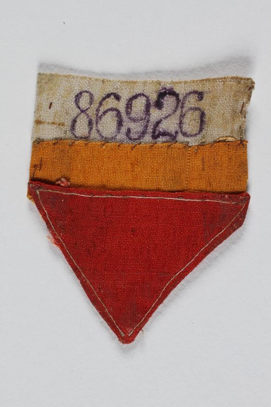 2000.188.2 front Prisoner badge with red triangle and number