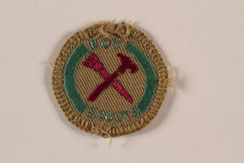 2000.24.13 front Boy Scout merit badge for home repairs issued to Jewish refugee