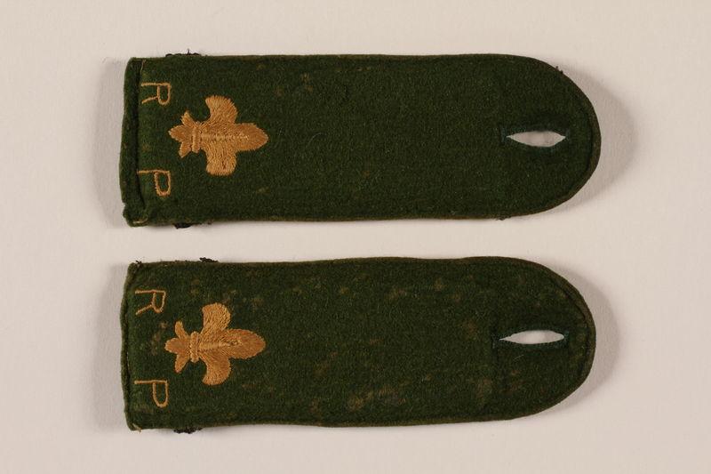 2000.24.14_a-b front Boy Scout shoulder board with RP and fleur de lis