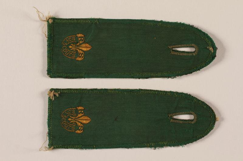 2000.24.15_a-b front Boy Scout shoulder board with RP and fleur de lis