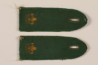 2000.24.15_a-b front Boy Scout shoulder board with RP and fleur de lis  Click to enlarge