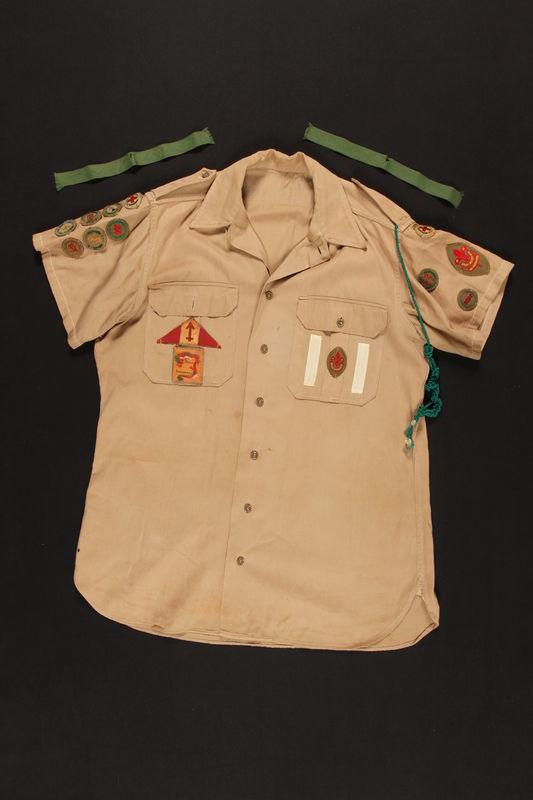 2000.24.35_a-b front Boy Scout uniform shirt worn in Shanghai