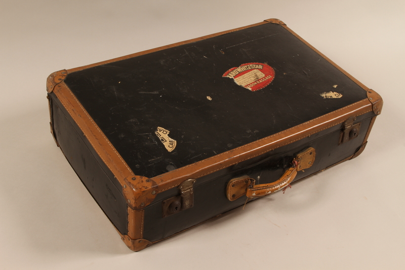 2000.258.1 front Black suitcase with leather trim used by a German Jewish Kindertransport refugee