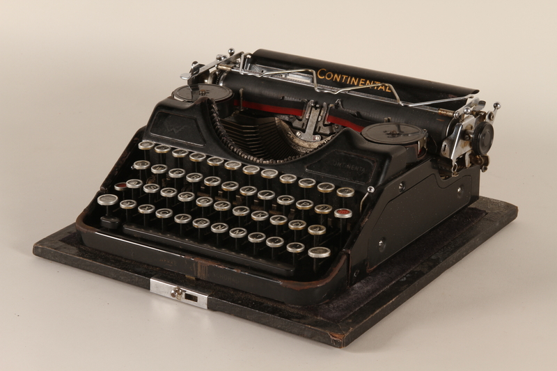 2000.281.1_a front Continental typewriter with a swastika and SS emblem key and a removable lid