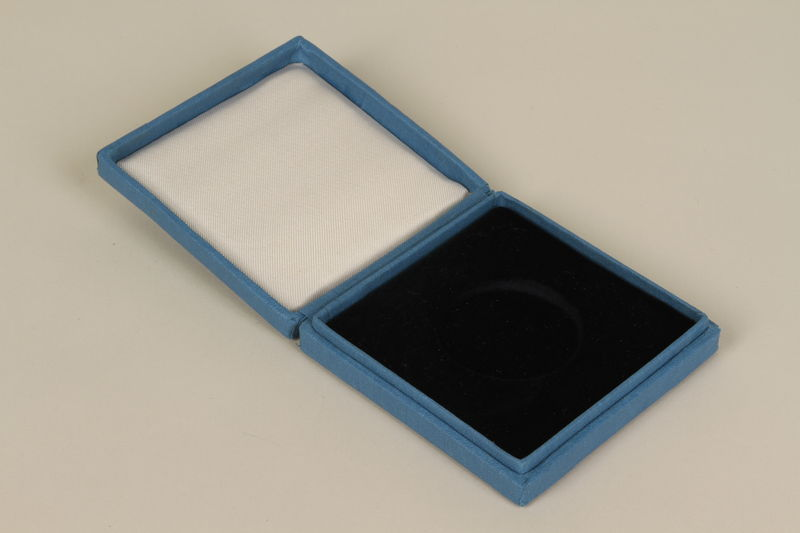 2000.313.1.2 front Commemorative coin case
