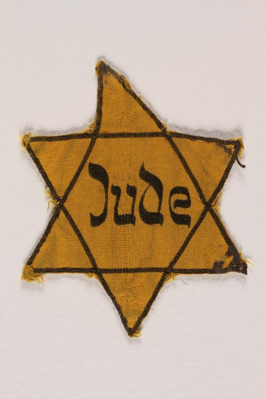 2000.332.1 front Star of David badge with Jude printed in the center