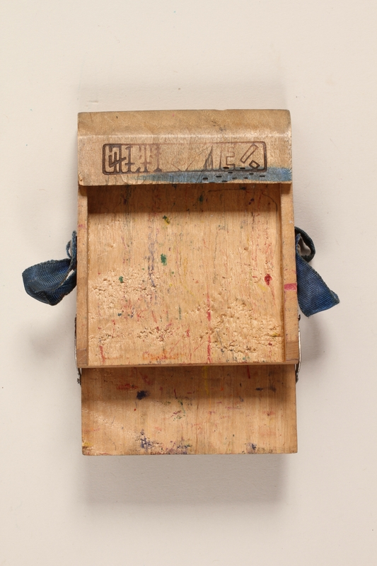 2001.235.2 open Wooden crayon box received by a Polish Jewish refugee boy in school in Japan