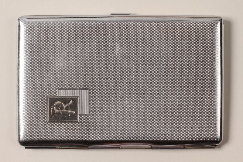 2001.236.1 front Cigarette case engraved with Camp Buchenwald